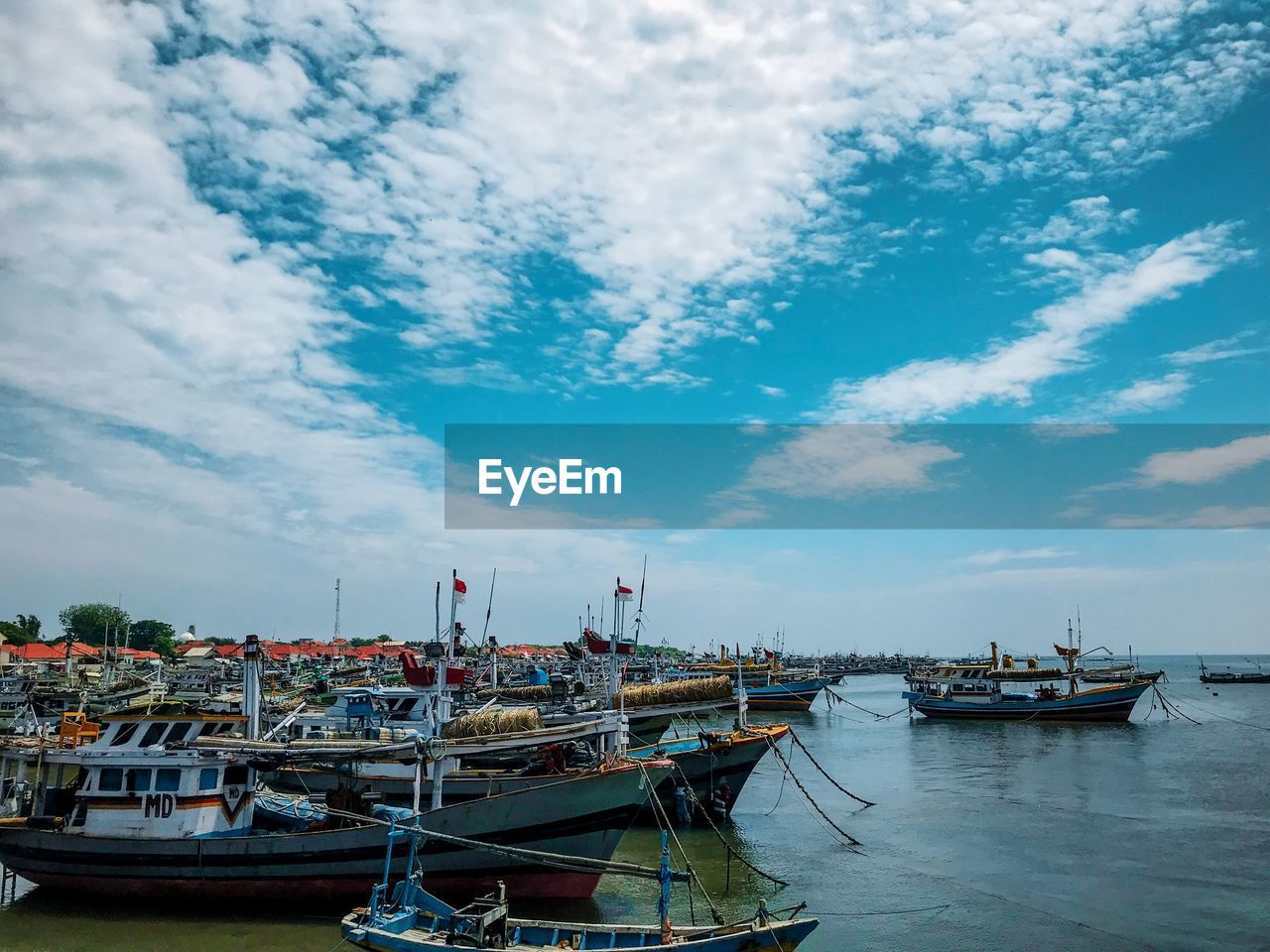 nautical vessel, cloud - sky, mode of transportation, transportation, water, moored, sky, harbor, nature, day, architecture, sea, waterfront, no people, building exterior, built structure, city, outdoors, travel, fishing industry, fishing boat, port, marina