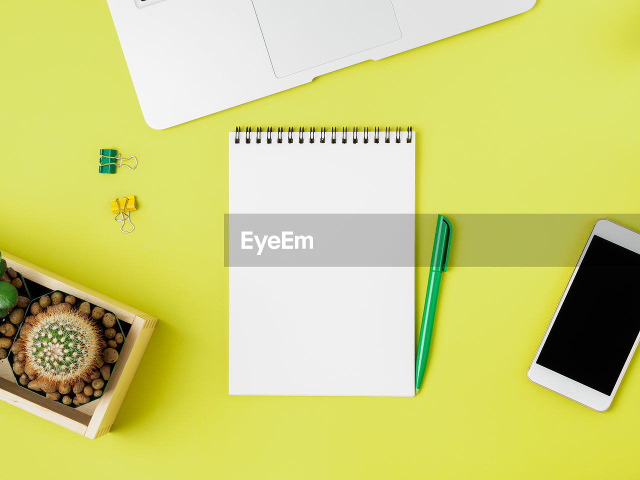 copy space, table, indoors, yellow, directly above, paper, blank, still life, pencil, high angle view, no people, pen, studio shot, art and craft, writing instrument, white color, office supply, food and drink, office, technology, note pad