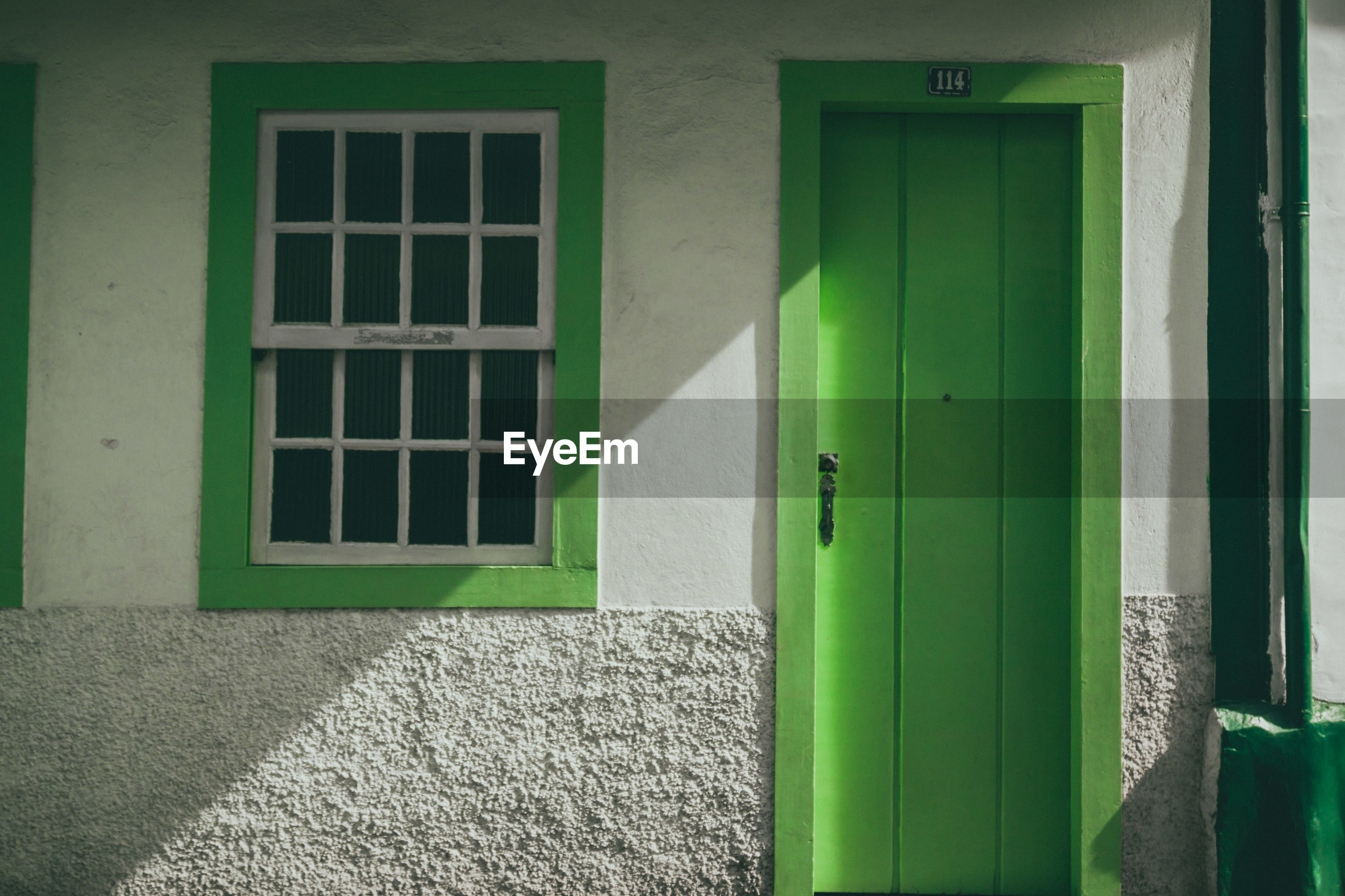 Close-up of house with green door and window