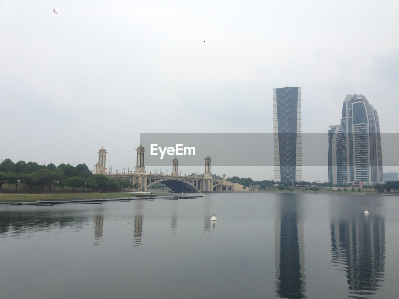 LAKE AND BUILDINGS AGAINST SKY