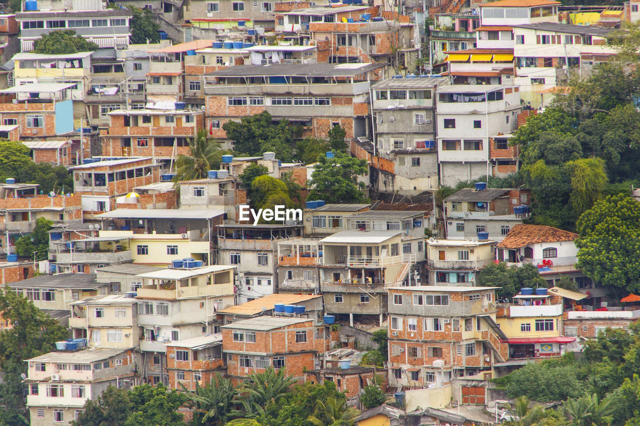 building exterior, architecture, built structure, tree, crowded, day, residential building, house, high angle view, outdoors, city, town, cityscape, nature