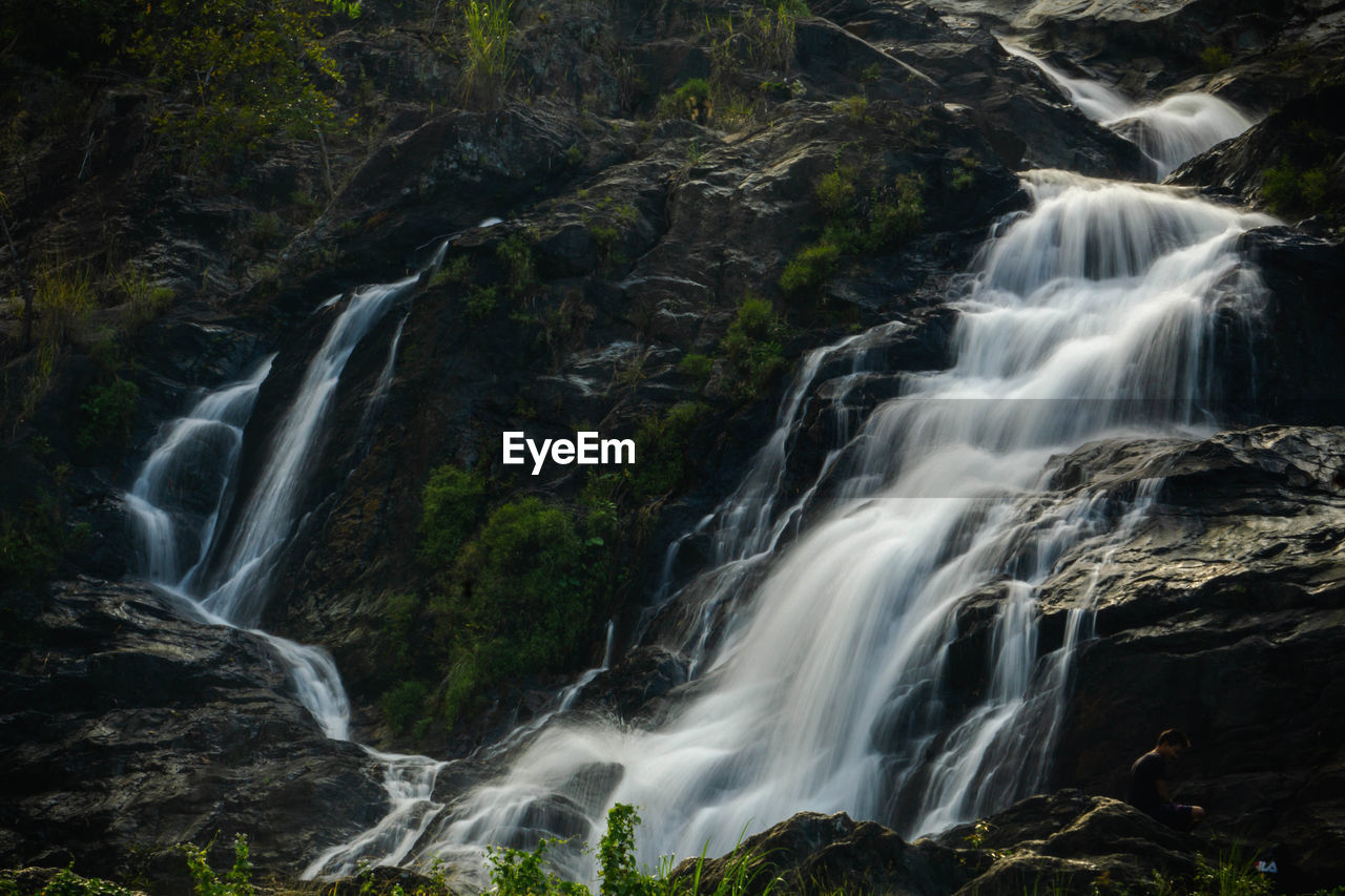 long exposure, beauty in nature, motion, waterfall, scenics - nature, rock, blurred motion, land, rock - object, water, environment, forest, nature, flowing water, no people, solid, non-urban scene, rock formation, power, outdoors, power in nature, flowing, rainforest, falling water