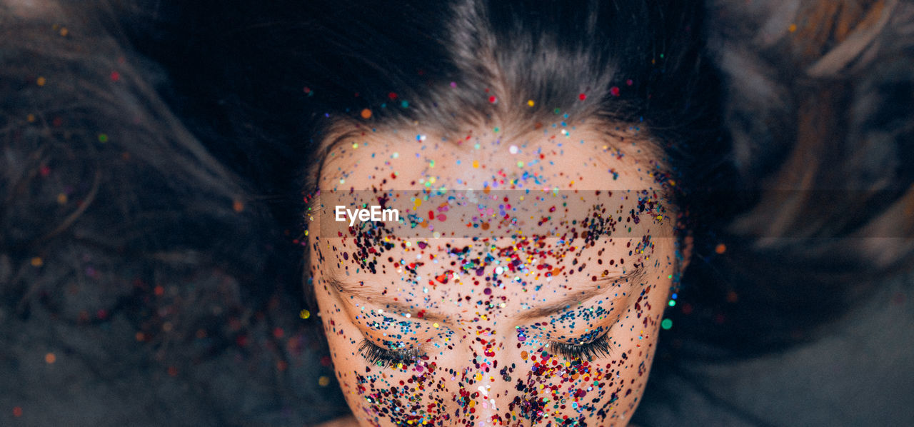 High Angle View Of Woman With Colorful Make-Up