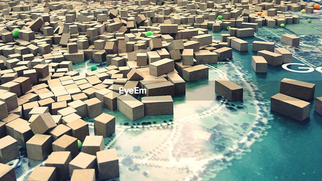large group of objects, no people, pattern, high angle view, block, architecture, day, design, cube shape, block shape, outdoors, abundance, built structure, building, close-up, shape, flooring, nature, sunlight