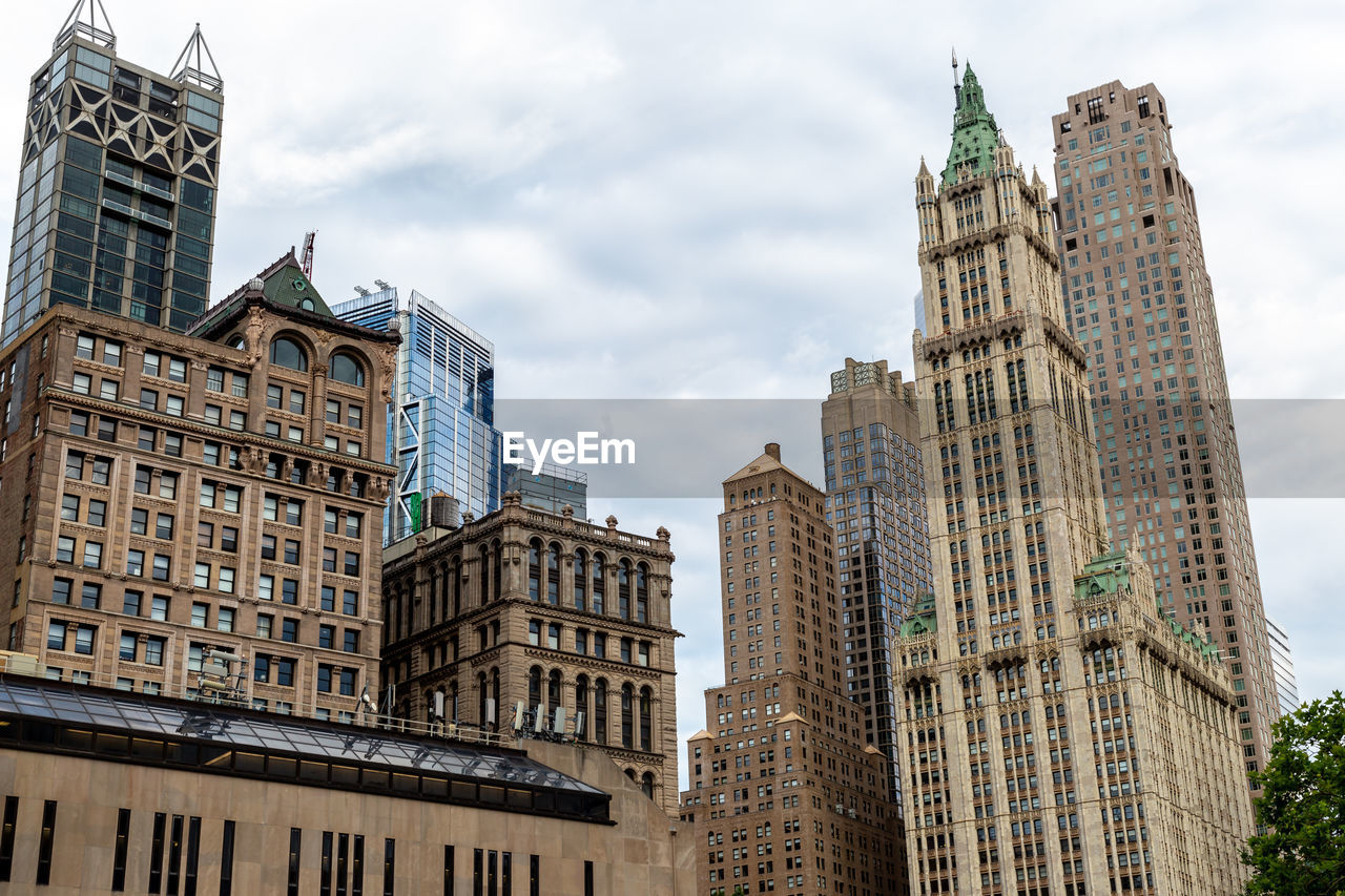 architecture, built structure, building exterior, building, city, sky, tower, office building exterior, cloud - sky, low angle view, tall - high, skyscraper, travel destinations, day, no people, modern, nature, tourism, office, travel, outdoors, spire, financial district