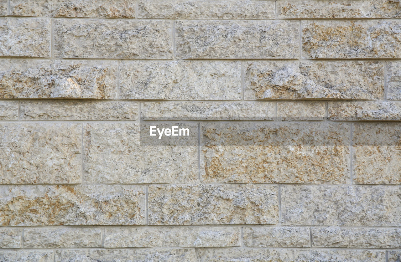 wall - building feature, backgrounds, textured, architecture, full frame, built structure, stone material, wall, stone wall, pattern, solid, no people, day, rough, weathered, close-up, old, outdoors, concrete, building exterior, textured effect, stack rock