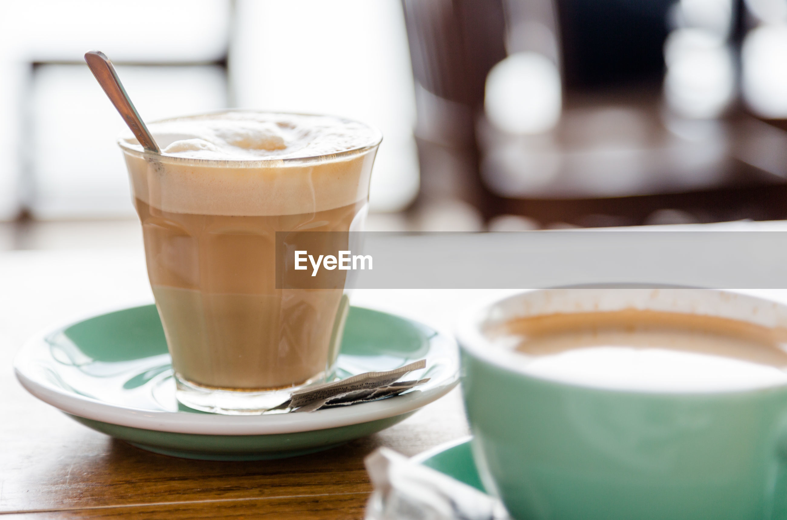 Close-up of cappuccino served on table