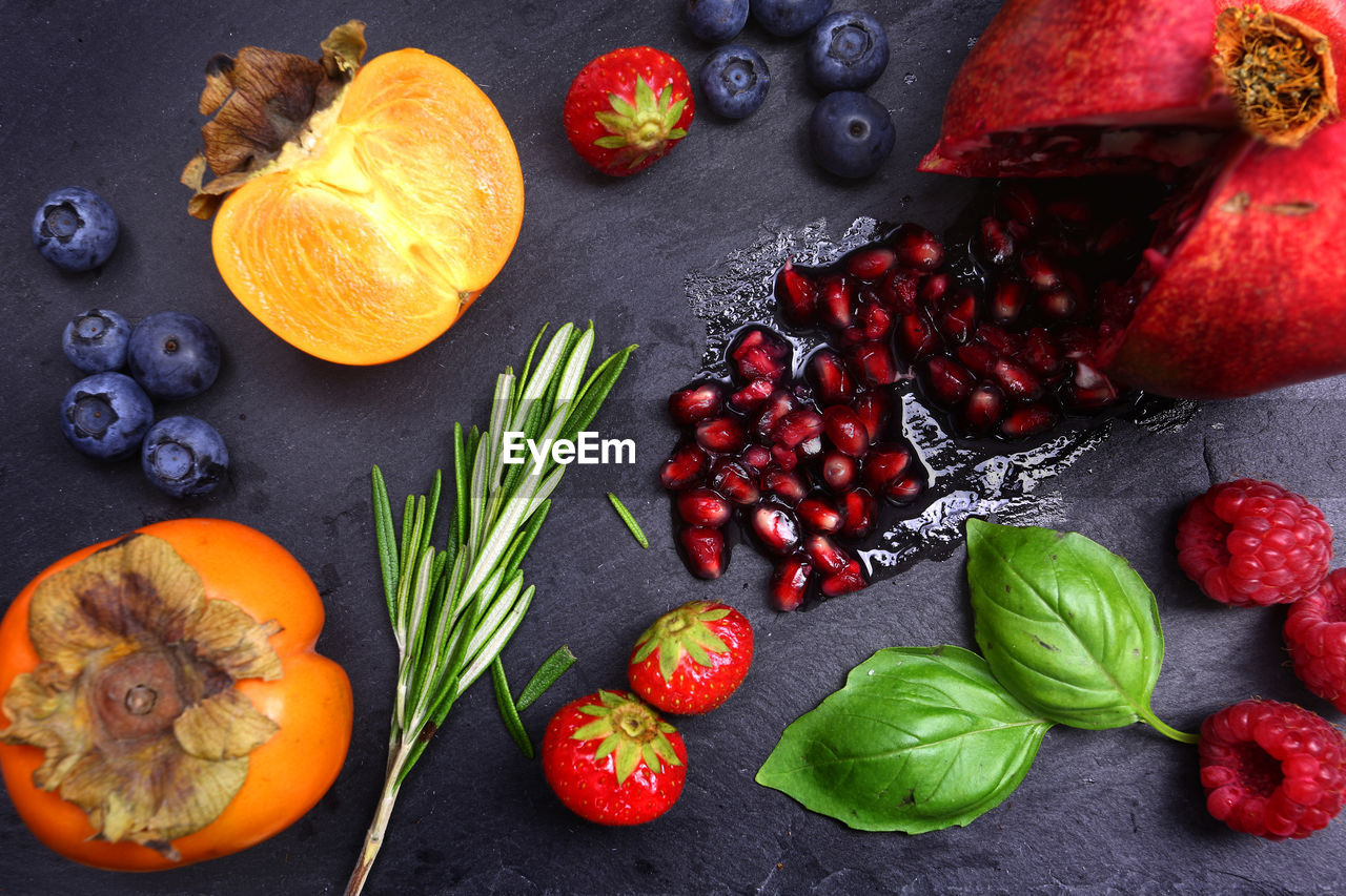 HIGH ANGLE VIEW OF FRUITS AND VEGETABLES ON LEAVES