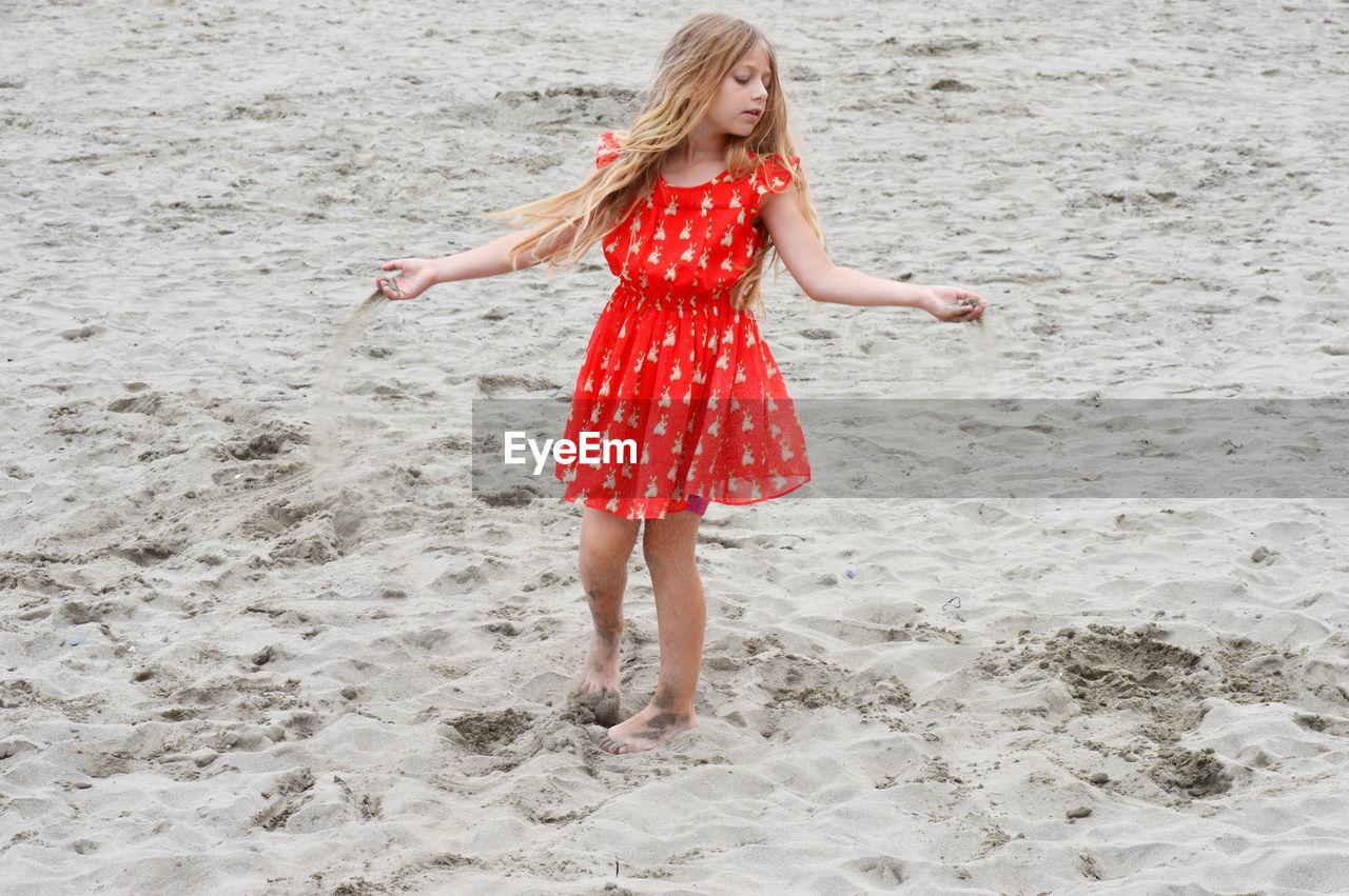 FULL LENGTH OF A GIRL ON BEACH