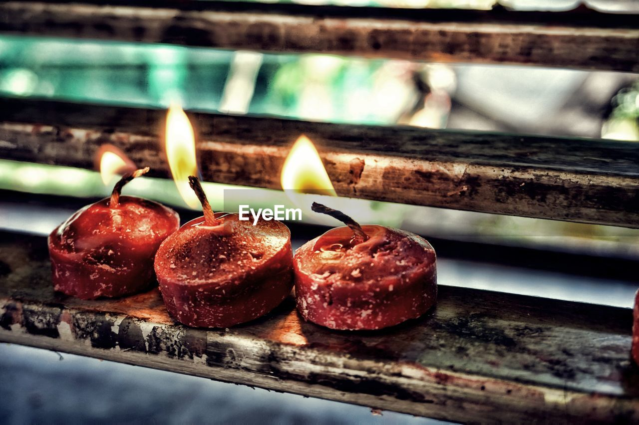 flame, burning, heat - temperature, candle, indoors, no people, close-up, focus on foreground, food and drink, preparation, cake, red, food, freshness, day
