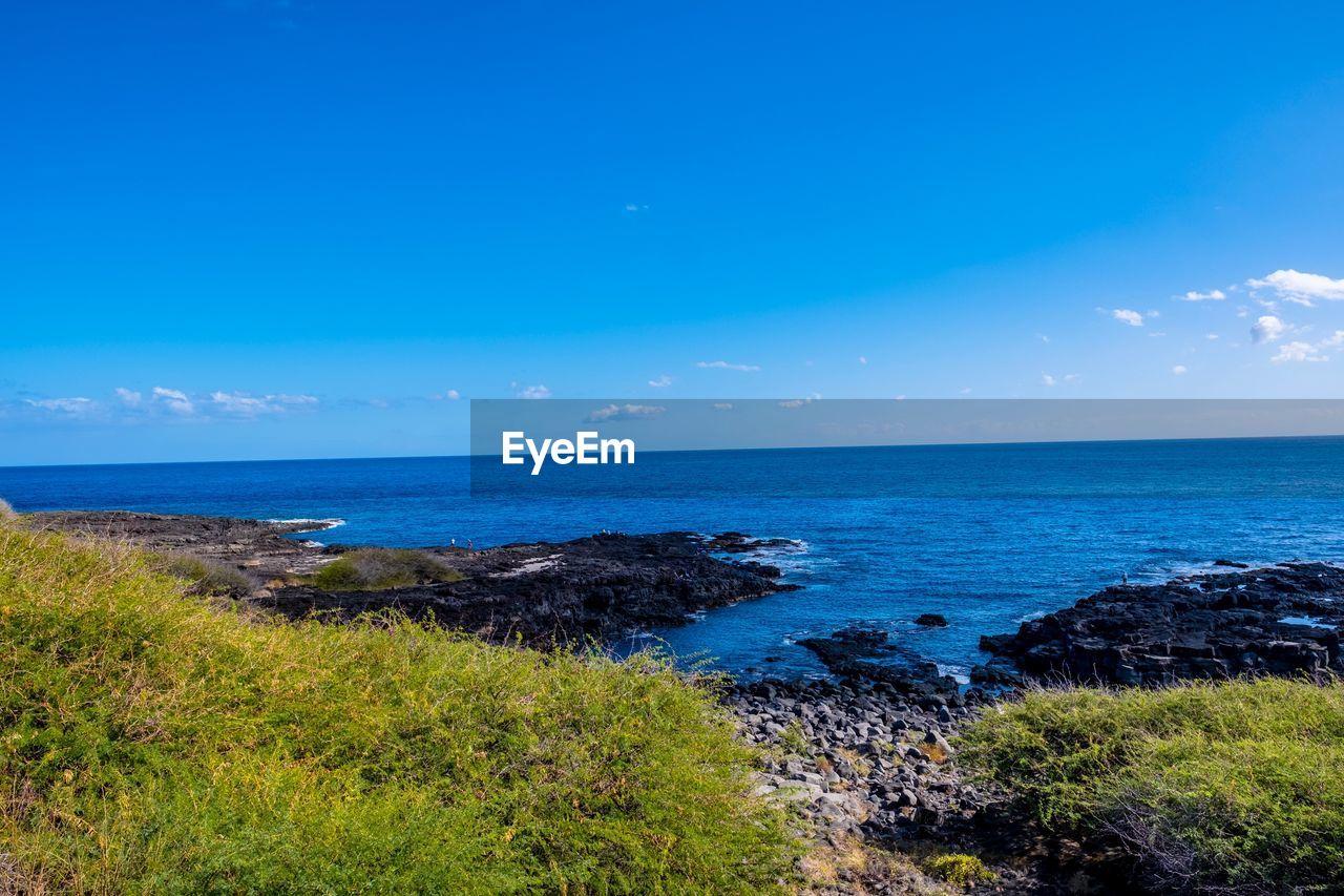 sea, water, sky, scenics - nature, horizon, beauty in nature, horizon over water, tranquil scene, blue, tranquility, land, plant, nature, no people, beach, day, non-urban scene, idyllic, grass, outdoors