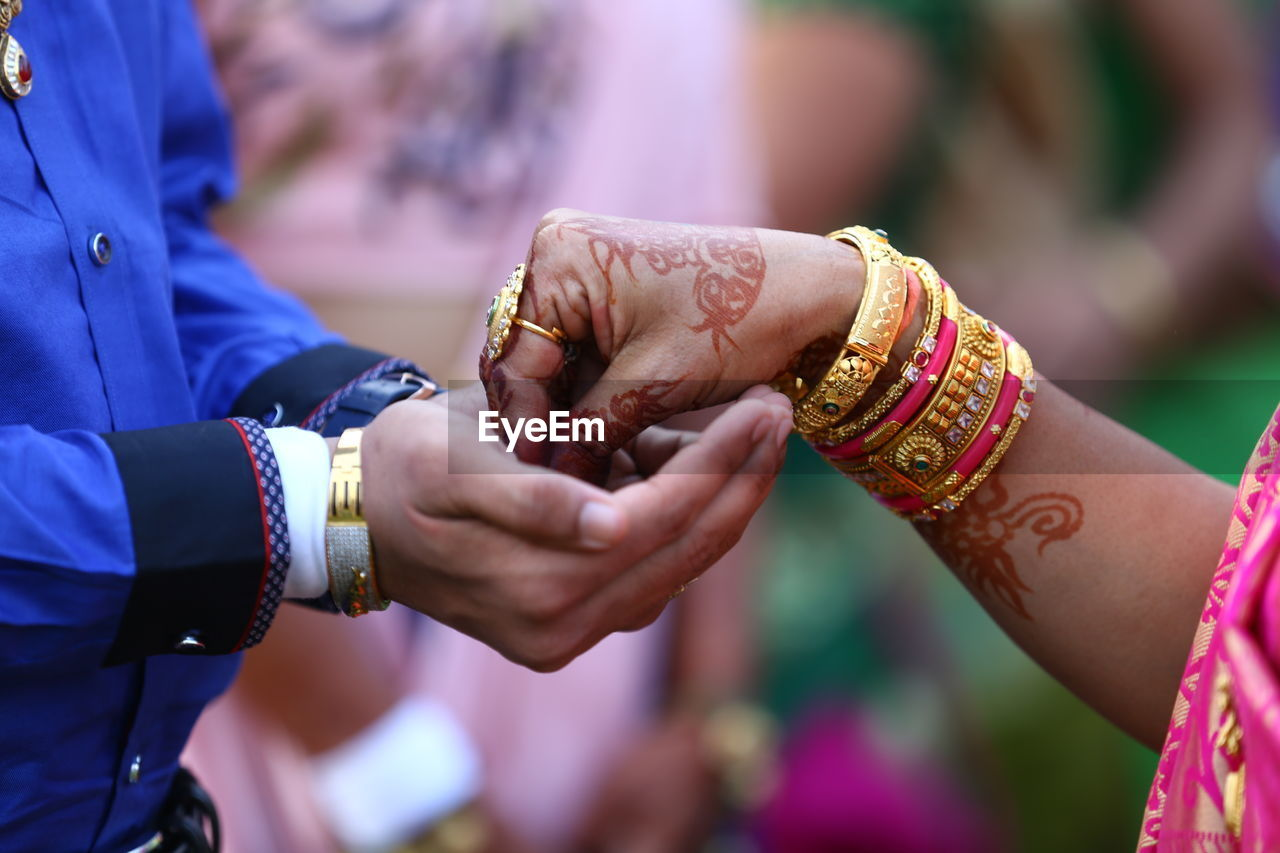 human hand, hand, wedding, life events, newlywed, two people, bride, event, real people, focus on foreground, celebration, wedding ceremony, women, men, adult, bracelet, human body part, ceremony, married, couple - relationship, positive emotion, traditional ceremony
