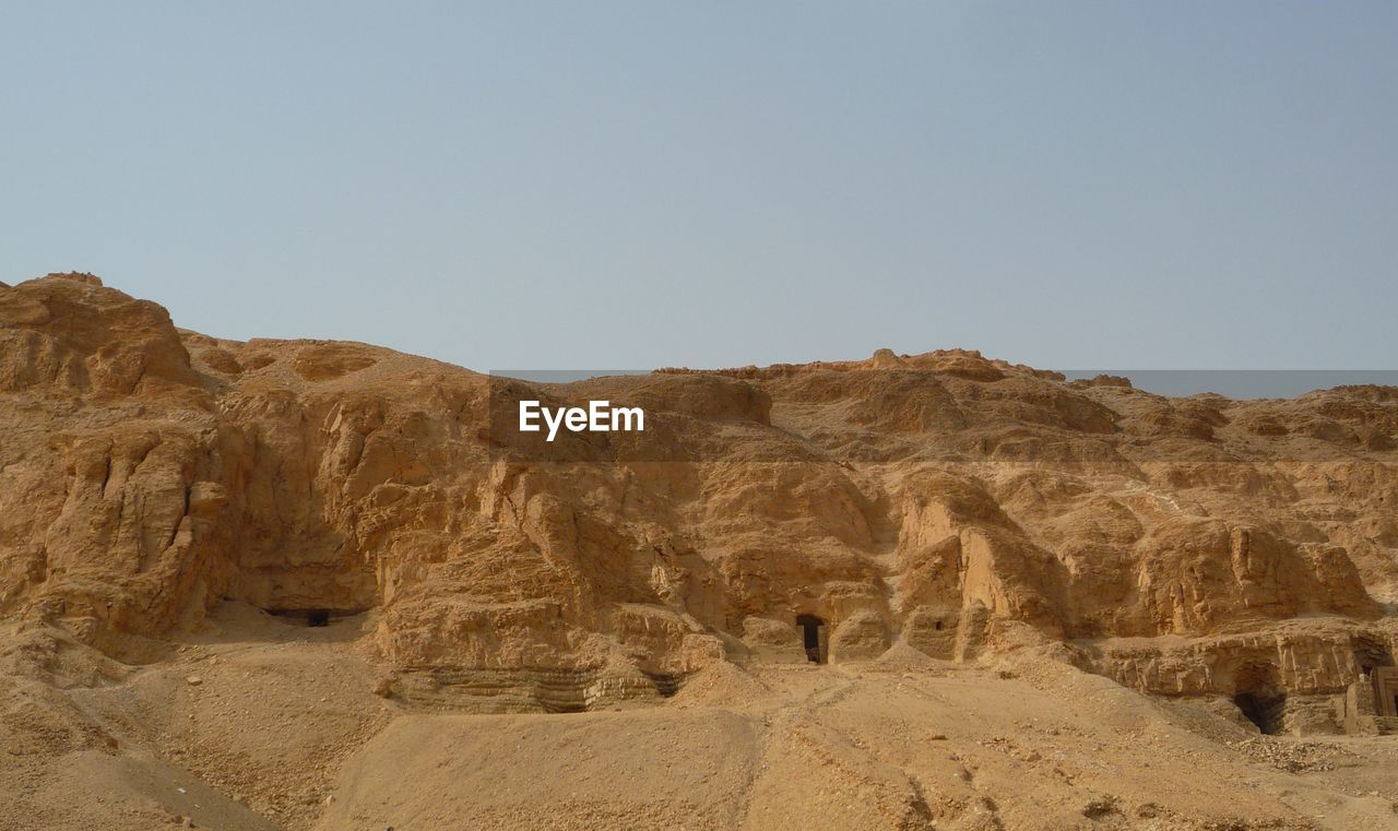 Scenic view of ancient civilization against clear sky