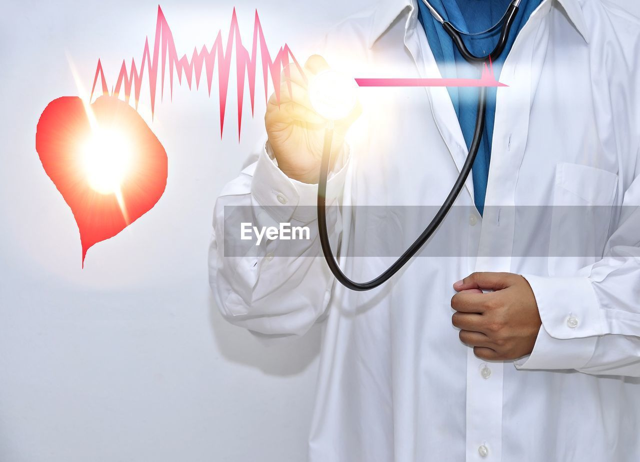Digital Composite Image Of Doctor Examining Pulse Rate With Stethoscope