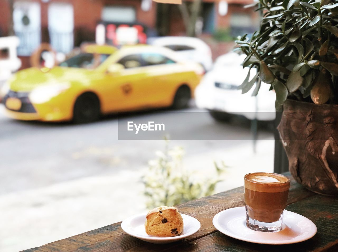 car, food and drink, motor vehicle, mode of transportation, coffee, table, drink, transportation, coffee - drink, coffee cup, cup, focus on foreground, food, freshness, land vehicle, mug, plate, architecture, refreshment, cafe, saucer, no people, crockery, latte