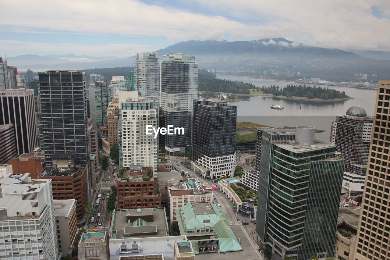 building exterior, architecture, built structure, building, city, cityscape, sky, cloud - sky, skyscraper, residential district, office building exterior, modern, crowd, nature, high angle view, crowded, outdoors, tall - high, urban skyline, high, apartment