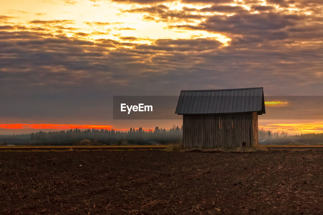 Built structure on countryside landscape against scenic sky