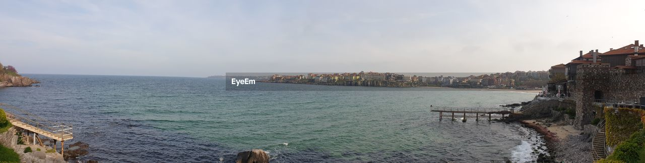 water, sky, sea, built structure, architecture, building exterior, nature, scenics - nature, city, cloud - sky, beauty in nature, day, beach, no people, land, panoramic, outdoors, nautical vessel, horizon, cityscape
