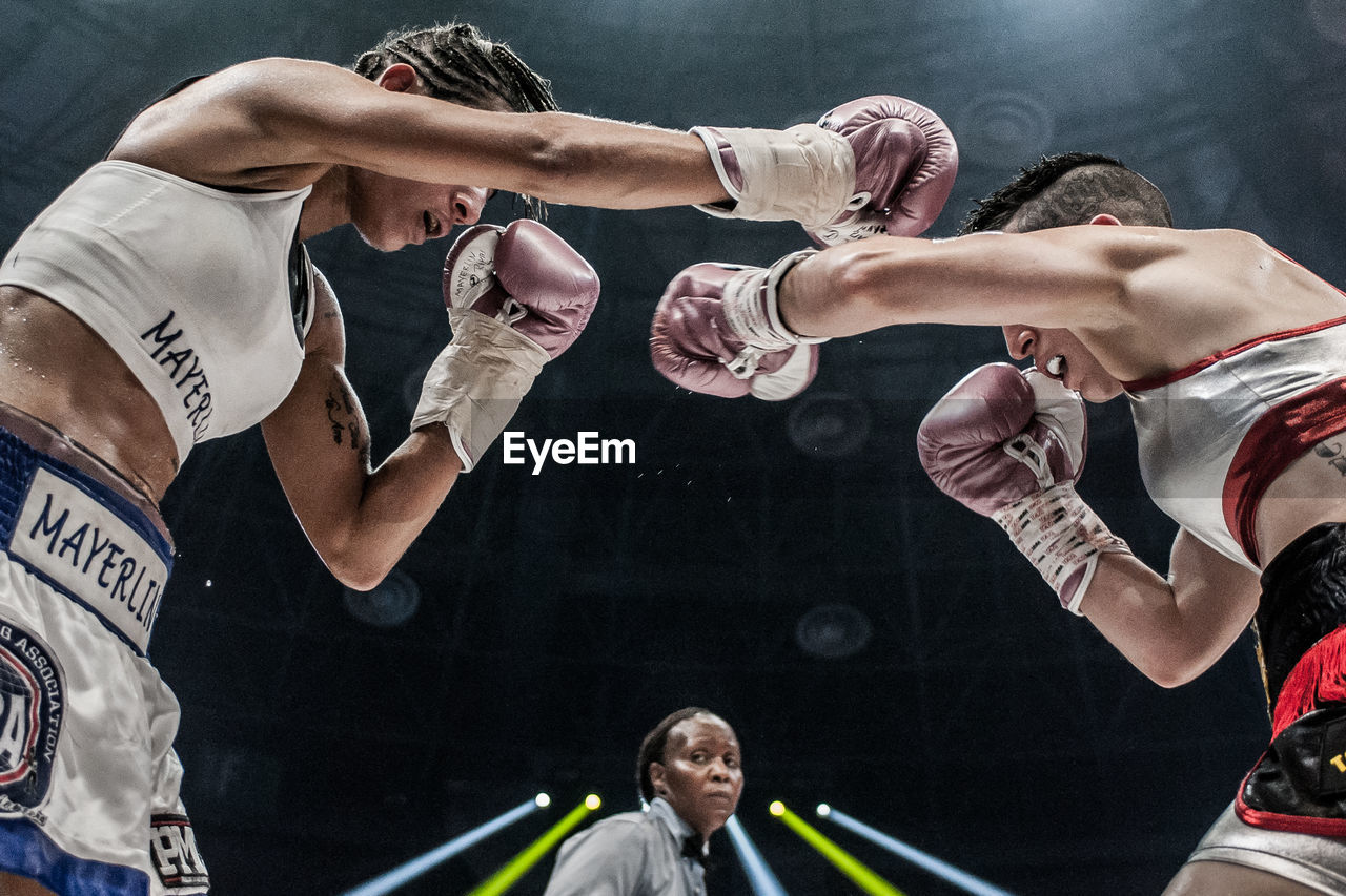 real people, men, competition, indoors, sport, sportsman, competitive sport, sports clothing, lifestyles, boxing glove, gym, young adult, boxing ring, athlete, sports team, day, people