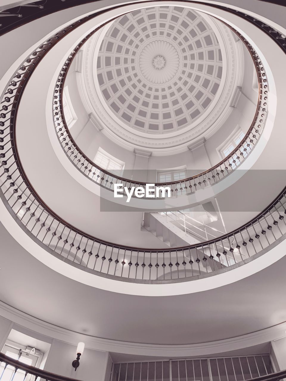 indoors, built structure, architecture, low angle view, ceiling, dome, pattern, no people, shape, architectural feature, spiral, geometric shape, design, staircase, railing, circle, sunlight, spiral staircase, cupola, directly below, ornate, architecture and art