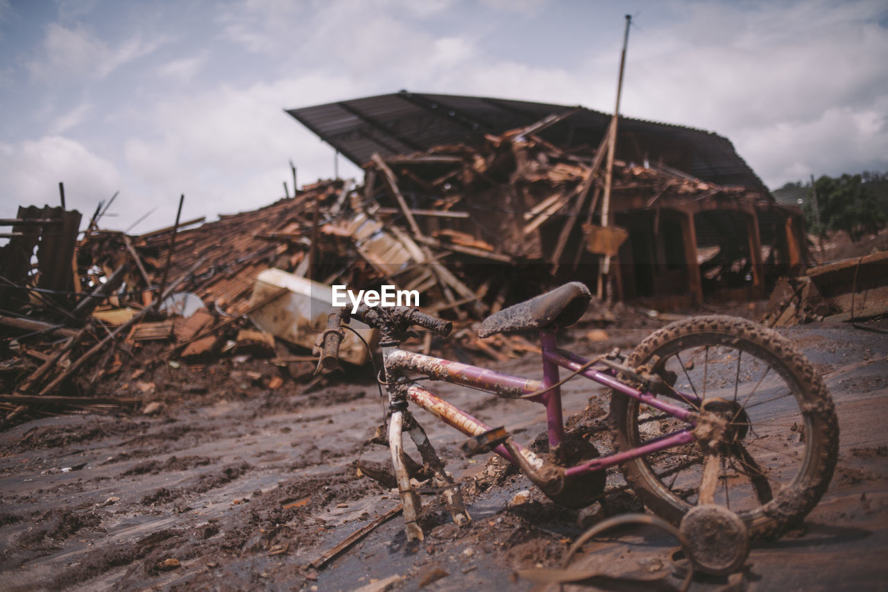 Damaged Bicycle And Houses By Tsunami