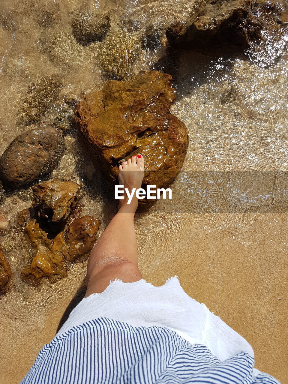 one person, water, real people, low section, human leg, lifestyles, sea, high angle view, leisure activity, barefoot, body part, nature, human body part, personal perspective, beach, human foot, adult, relaxation