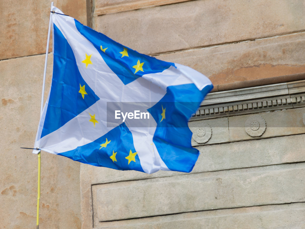 Low Angle View Of Scottish Flag Against Wall