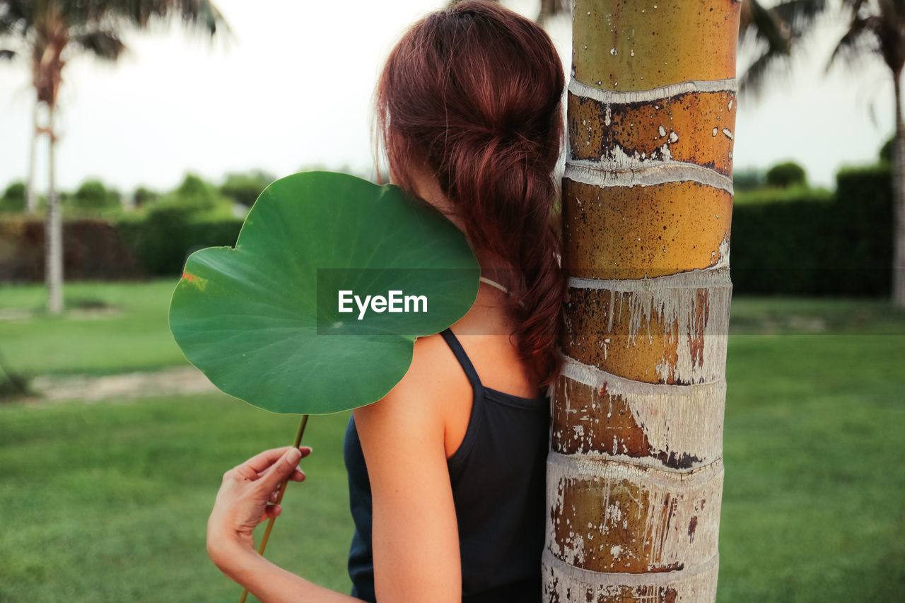 Leaf me here Back View Grass Portrait Of A Woman Sicily Summertime Beauty In Nature Close-up Garden Green Color Holding Leaf Lifestyles Nature One Person Outdoors Portraiture Real People Red Hair Tree Tree Trunk Woman Portrait Inner Power