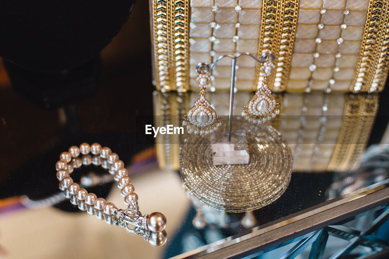 jewelry, necklace, luxury, fashion, wealth, hanging, indoors, elegance, gold colored, for sale, no people, retail, store, variation, close-up, jewelry store, day