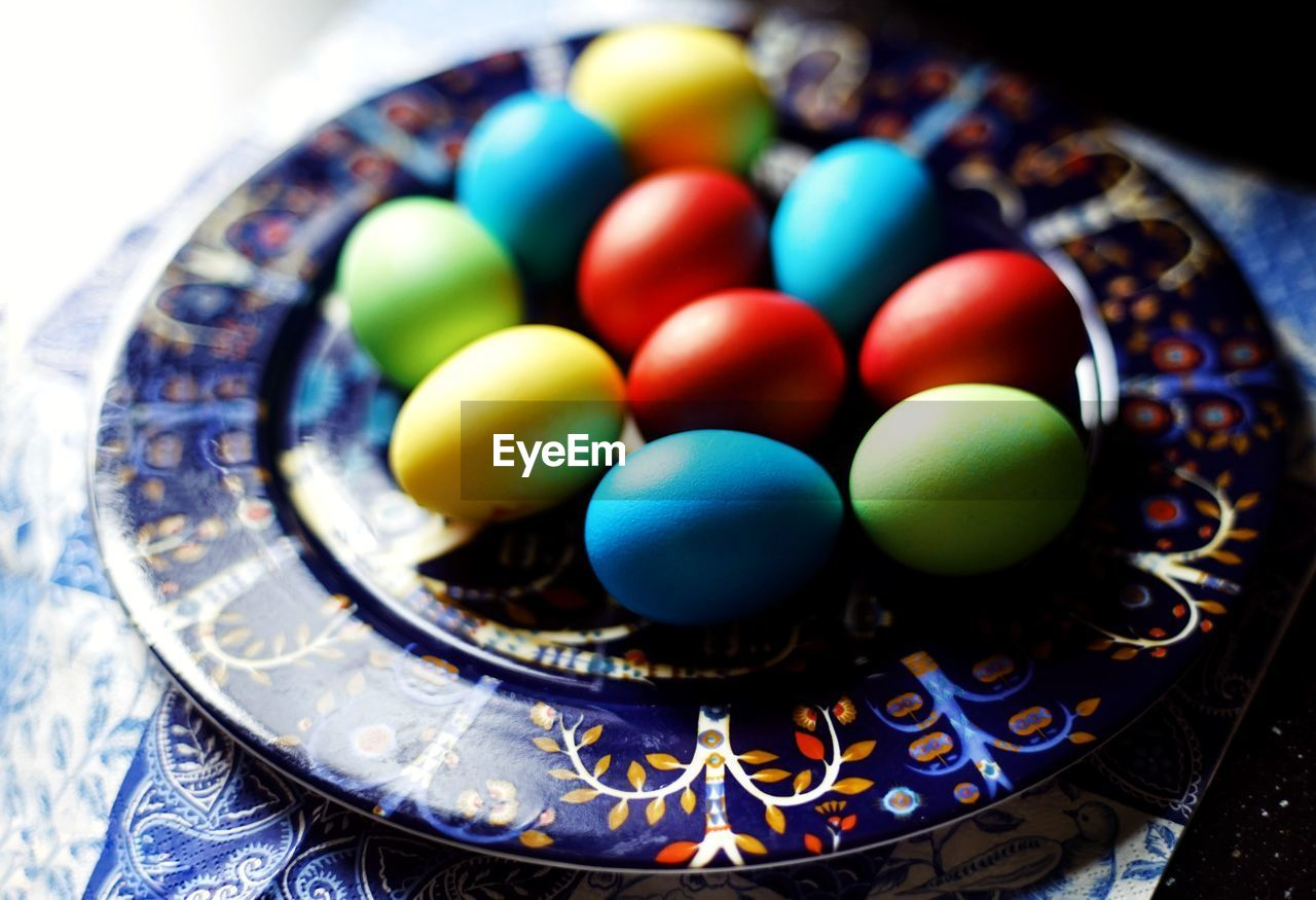multi colored, indoors, food, no people, still life, high angle view, close-up, large group of objects, plate, food and drink, egg, table, focus on foreground, shape, design, bowl, freshness, selective focus, circle, geometric shape, temptation