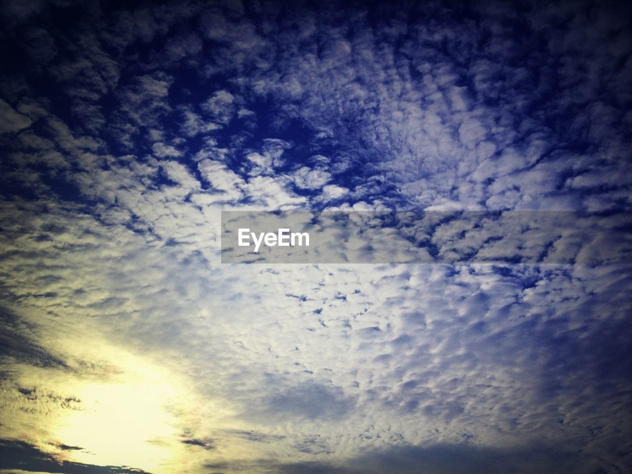 cloud - sky, beauty in nature, sky, nature, cloudscape, low angle view, sky only, scenics, backgrounds, heaven, majestic, awe, no people, dramatic sky, tranquility, tranquil scene, outdoors, sunset, blue, day