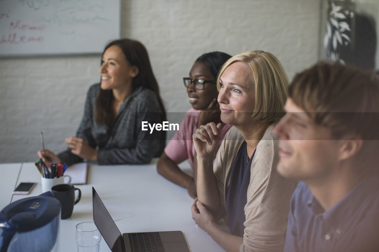 women, indoors, adult, communication, group of people, office, portrait, business person, headshot, table, technology, females, young women, mid adult, young adult, mid adult women, real people, businesswoman, mature adult, wireless technology, coworker, teamwork