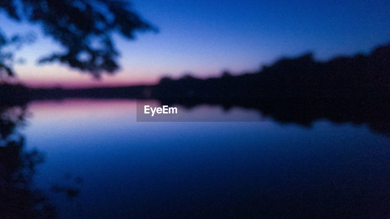 reflection, tranquility, blue, sky, scenics, silhouette, nature, tranquil scene, beauty in nature, dusk, lake, water, sunset, no people, outdoors, tree, night, close-up
