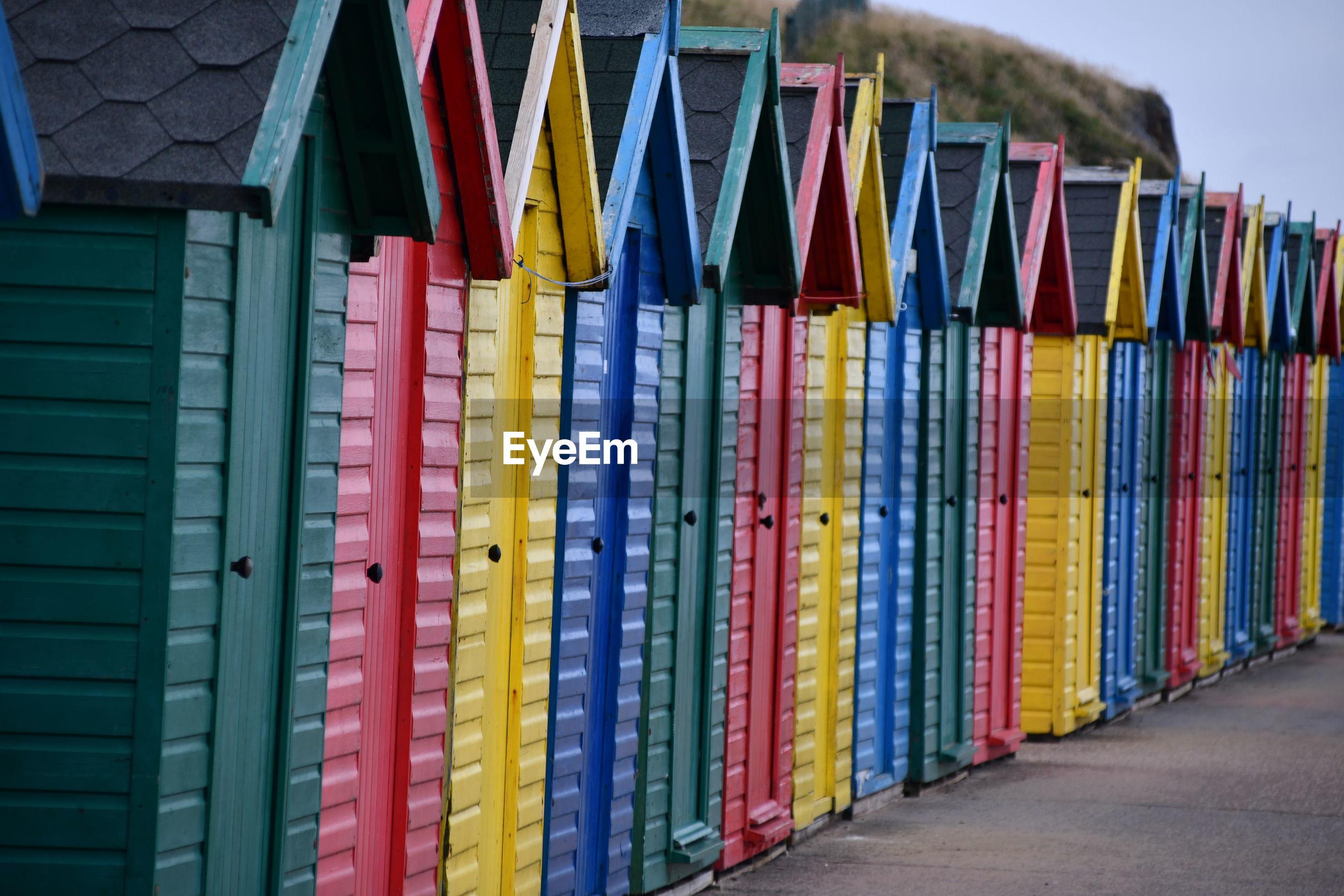 Close-up of multi colored beach huts
