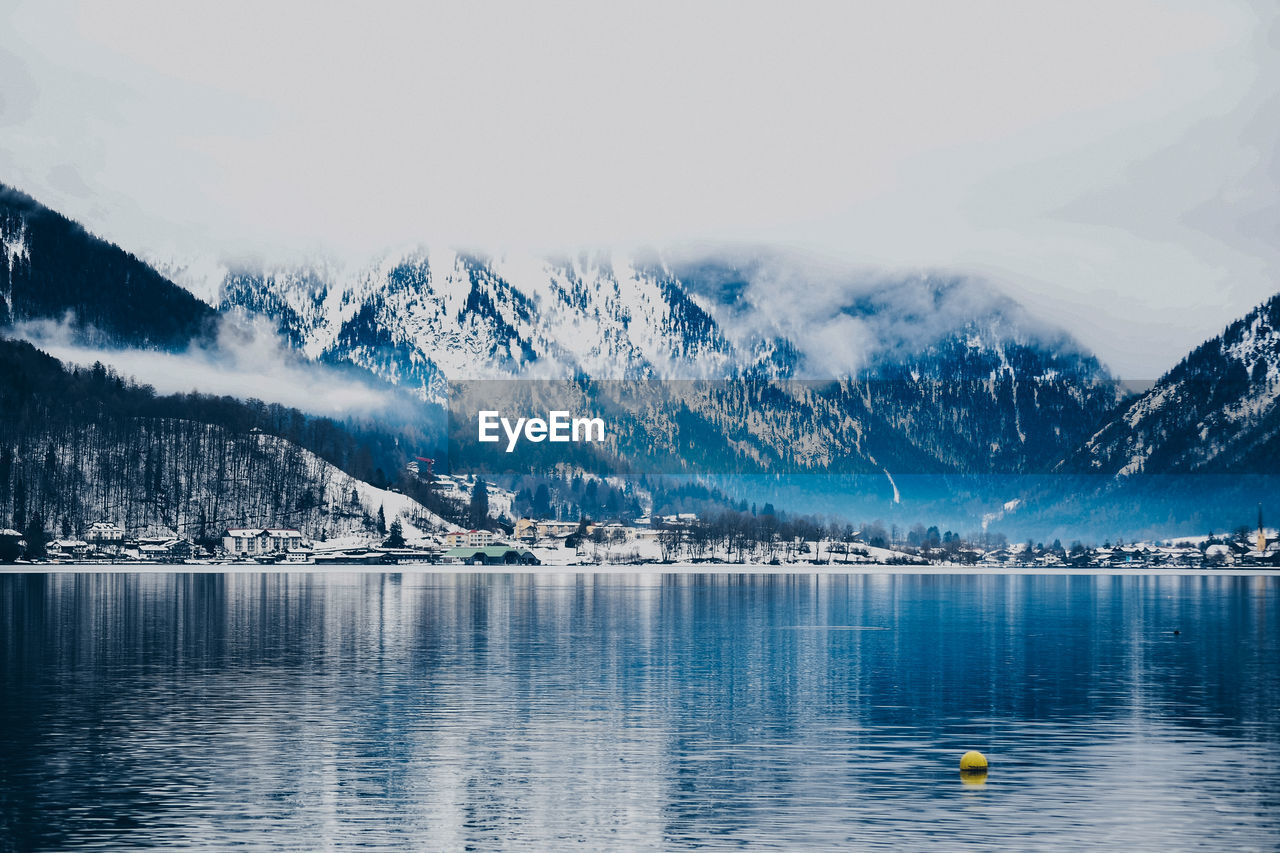 mountain, cold temperature, scenics - nature, winter, water, beauty in nature, snow, sky, lake, waterfront, tranquil scene, tranquility, nature, mountain range, no people, snowcapped mountain, non-urban scene, environment, ice, outdoors
