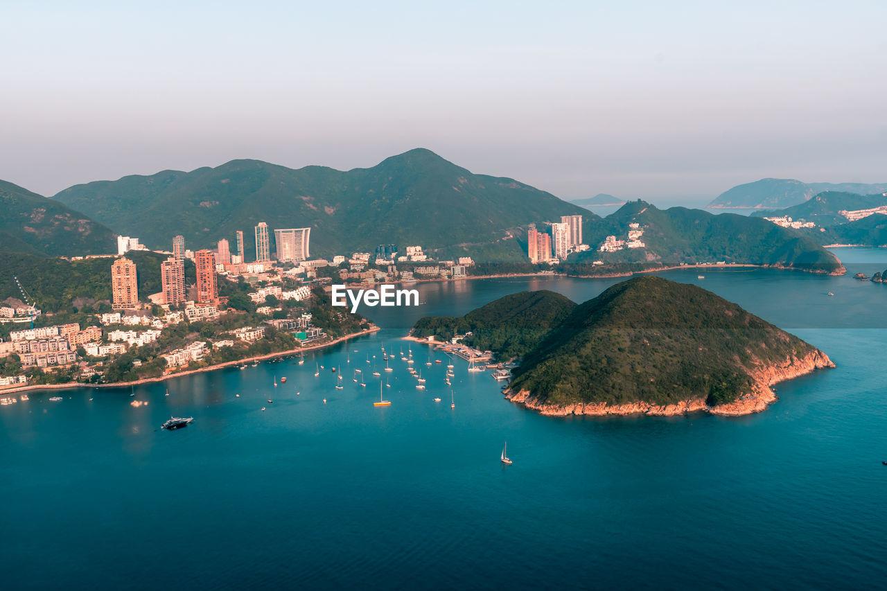 View of middle islands buildings in seaside at deep water bay hong kong seen form nam long shan