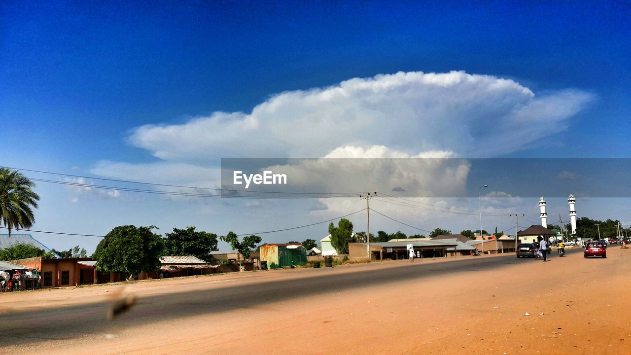 sky, car, road, cloud - sky, day, no people, outdoors, tree, city, nature