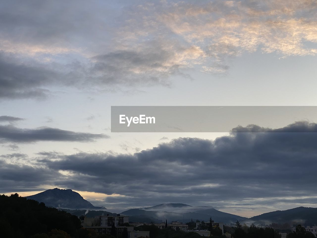 cloud - sky, sky, mountain, beauty in nature, scenics - nature, tranquility, mountain range, nature, tranquil scene, no people, sunset, silhouette, outdoors, idyllic, landscape, non-urban scene, environment, sunlight, day, mountain peak