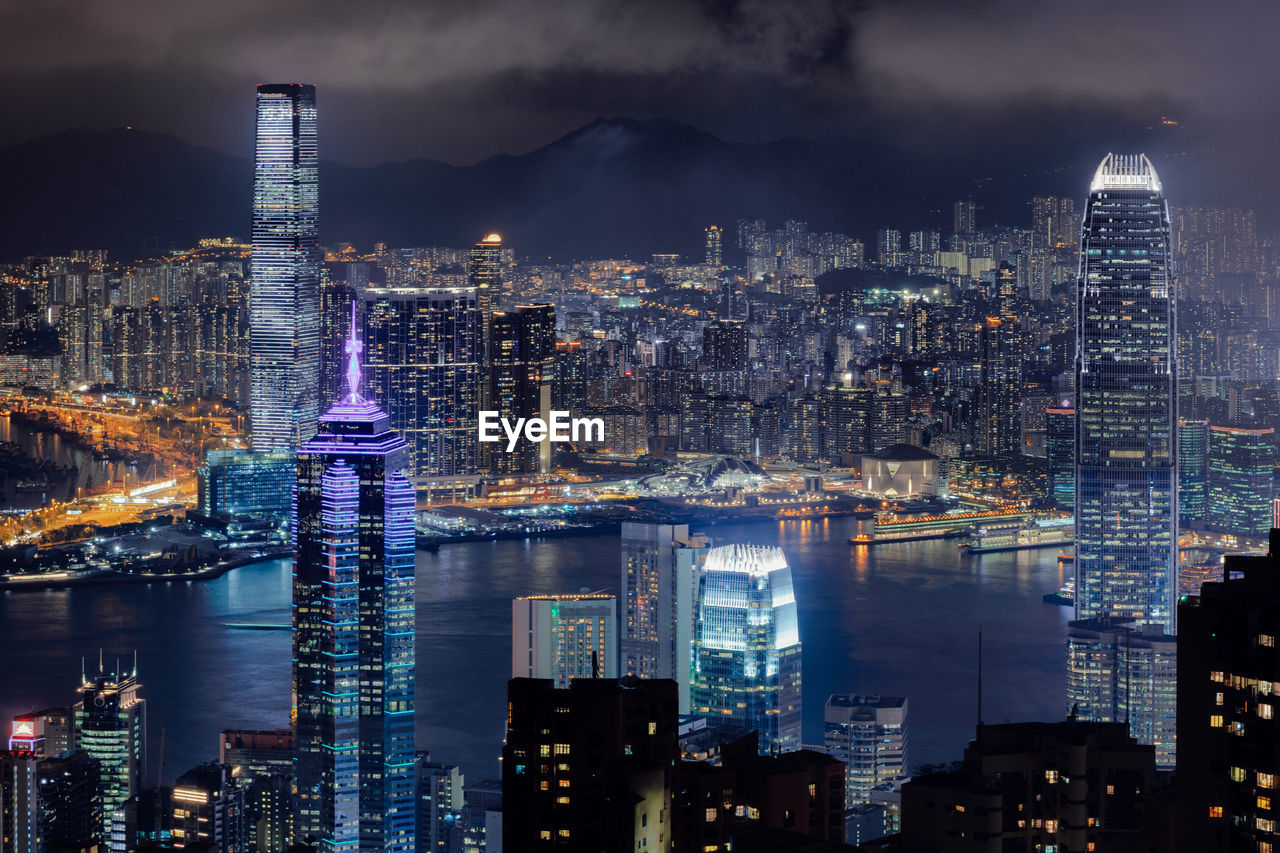 building exterior, architecture, built structure, city, building, cityscape, office building exterior, illuminated, skyscraper, night, water, sky, modern, tall - high, tower, no people, cloud - sky, urban skyline, nature, financial district, outdoors, light