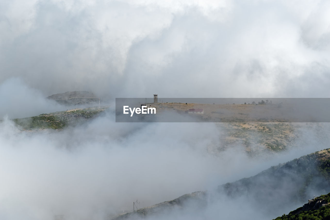 View of mountain amidst cloud
