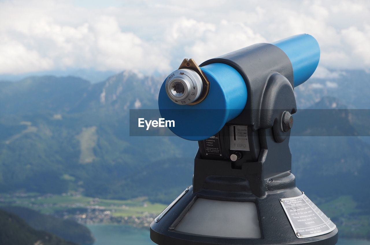 mountain, binoculars, coin operated, scenics - nature, surveillance, cloud - sky, nature, sky, mountain range, day, beauty in nature, focus on foreground, non-urban scene, no people, tranquil scene, coin-operated binoculars, technology, close-up, security, landscape, outdoors, hand-held telescope, mountain peak