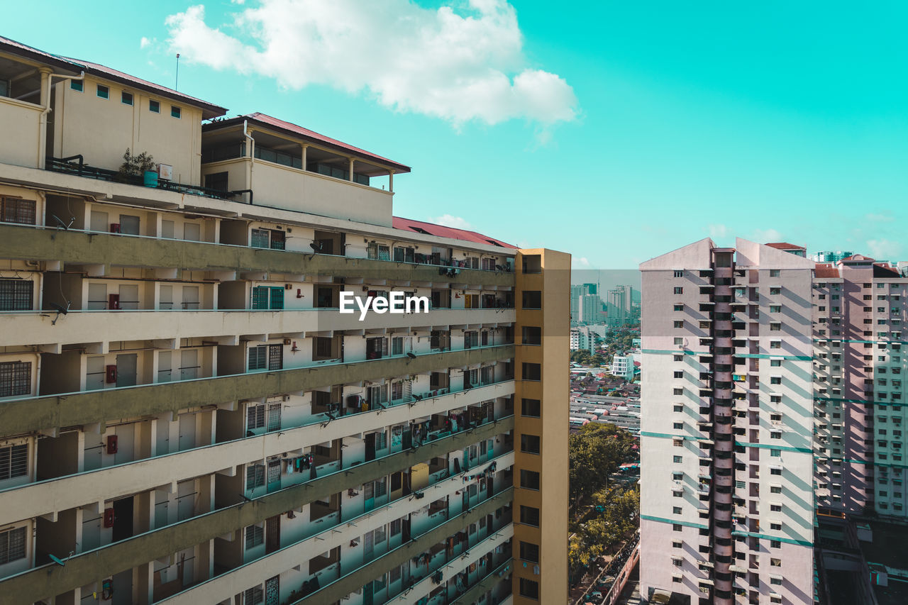 building exterior, architecture, built structure, building, sky, city, residential district, cloud - sky, no people, day, nature, window, outdoors, apartment, tower, low angle view, skyscraper, office building exterior, sunlight, modern