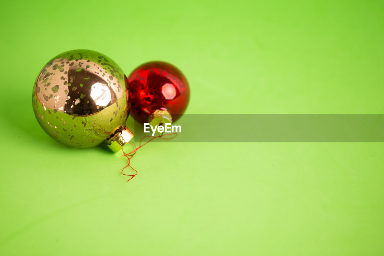 indoors, colored background, studio shot, still life, close-up, green color, copy space, green background, no people, food, food and drink, celebration, healthy eating, red, holiday, table, cut out, egg, selective focus