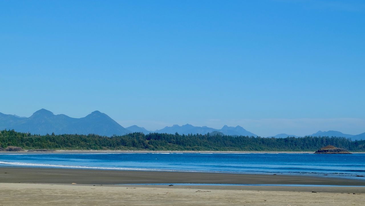 sky, land, mountain, beauty in nature, sea, copy space, beach, water, tranquility, tranquil scene, scenics - nature, blue, clear sky, nature, sand, no people, idyllic, day, non-urban scene, outdoors