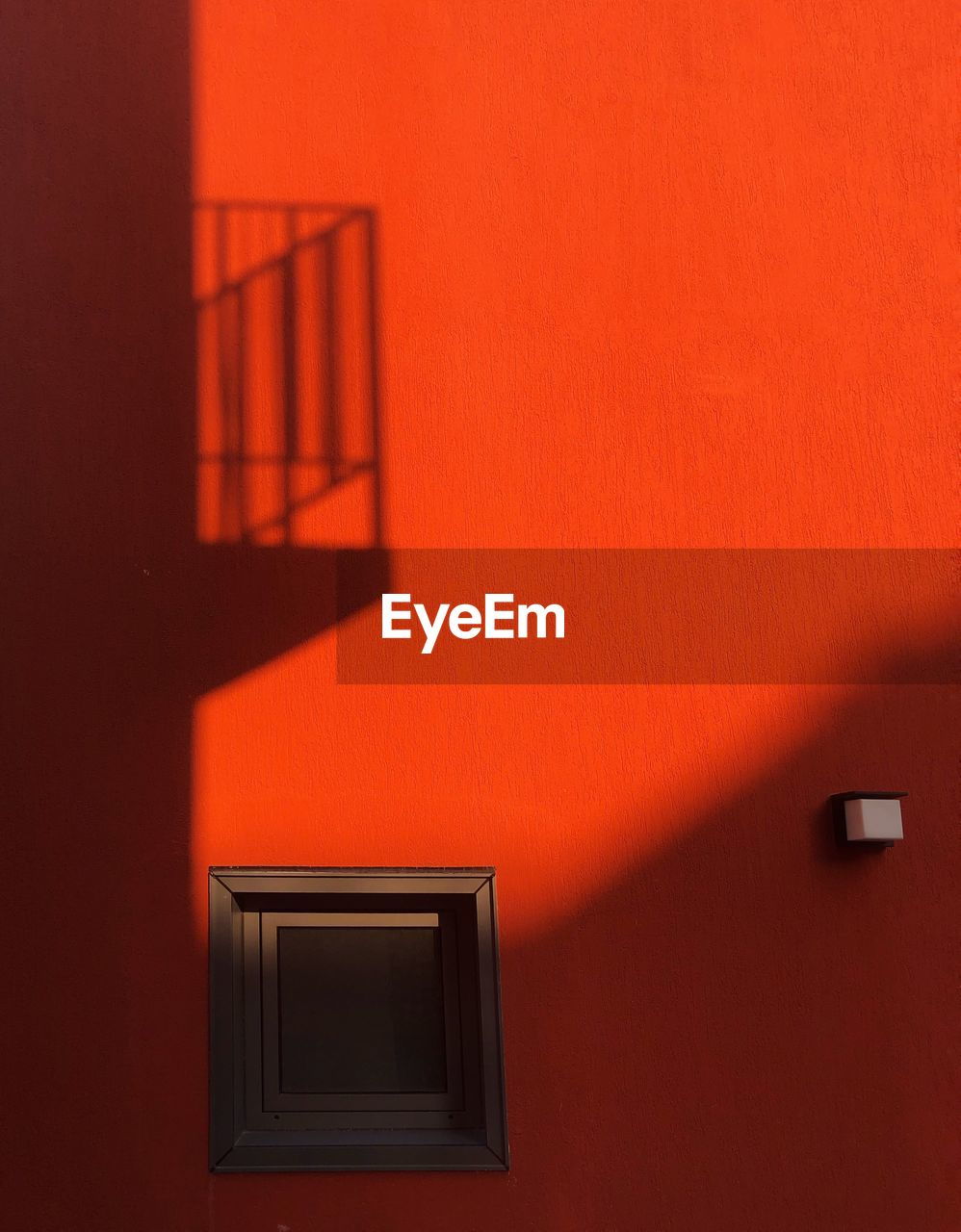 architecture, built structure, wall - building feature, no people, orange color, building exterior, building, shadow, window, red, railing, door, wall, geometric shape, house, staircase, entrance, home interior, focus on shadow