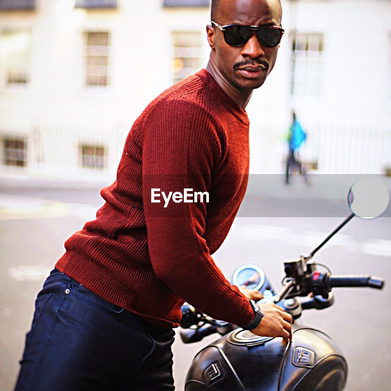 sunglasses, one person, mode of transport, bicycle, transportation, cycling, motorcycle, lifestyles, riding, outdoors, land vehicle, men, standing, one man only, real people, young adult, leisure activity, day, adult, adults only, only men, people, biker, city, building exterior