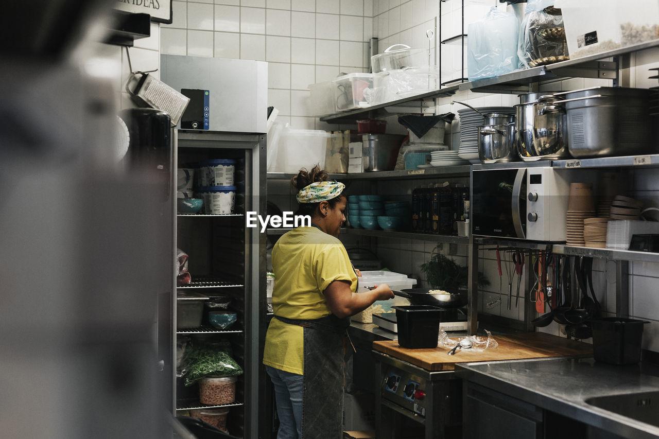 MAN WORKING IN KITCHEN AT OFFICE