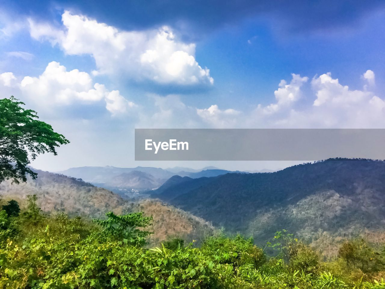 sky, beauty in nature, cloud - sky, plant, scenics - nature, tranquil scene, mountain, tranquility, environment, nature, landscape, day, tree, growth, non-urban scene, no people, idyllic, land, mountain range, green color, outdoors