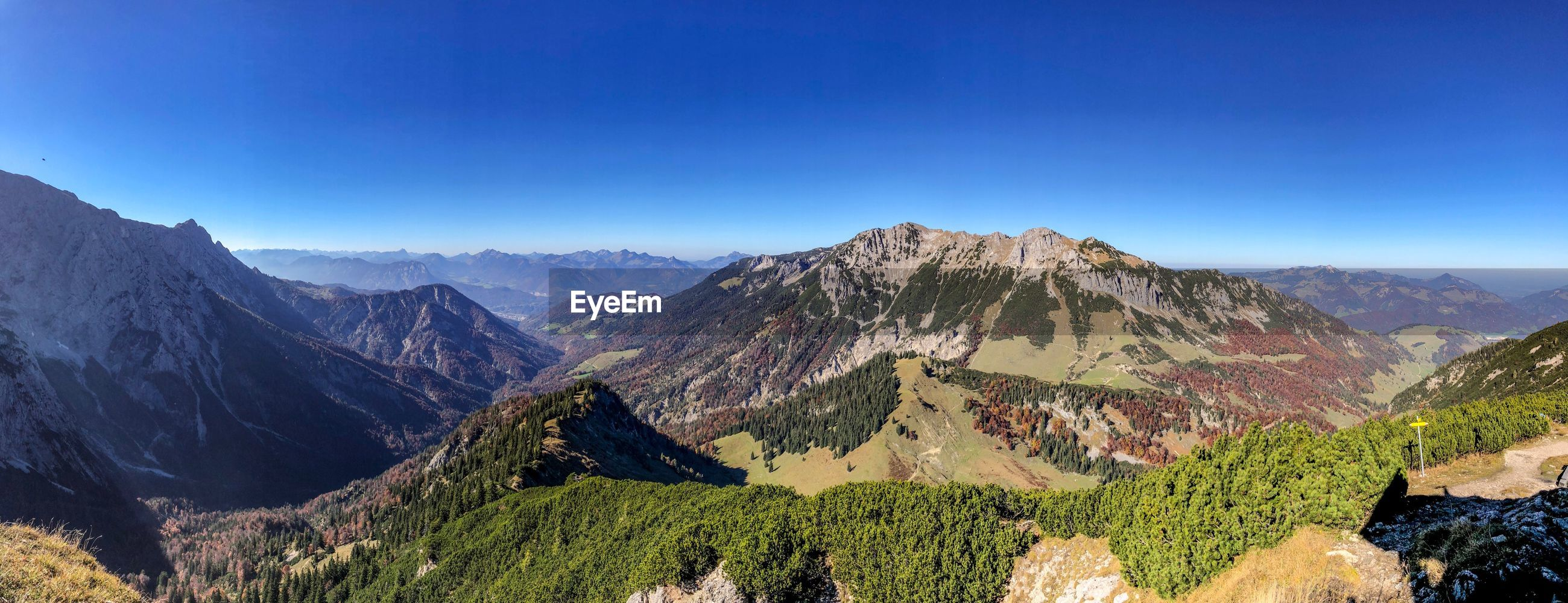PANORAMIC VIEW OF MOUNTAIN RANGE AGAINST BLUE SKY