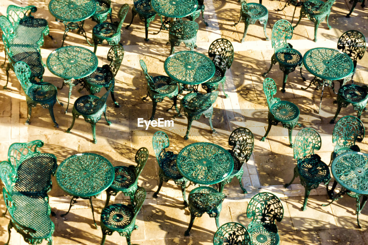 Full frame shot of tables and chairs during sunny day